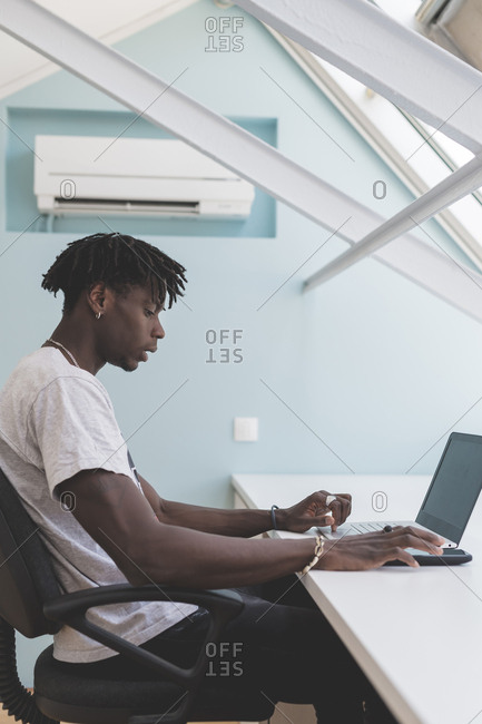 Young man indoor at home using laptop computer