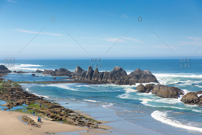 View of Seal Rock beach from above in Lincoln County, Oregon on a warm, cloudless summer day.