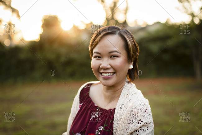 Portrait of Asian woman at sunset
