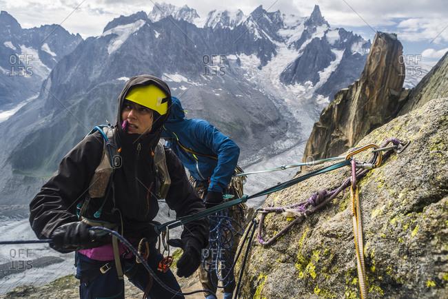 Rock climbers rappelling in French Alps, Le Soleil Rendez-Vous avec la Lune on Grepon, Aiguille du Grepon, Haute-Savoie, France