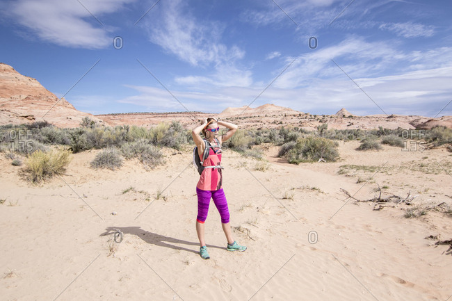 Woman standing in desert scenery of Grand Staircase-Escalante National Monument, Utah, USA