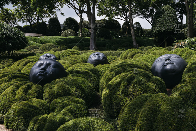 Etretat, Normandy, France - May 30, 2018: Round head sculptures in a garden in Les Jardins D'Etretat