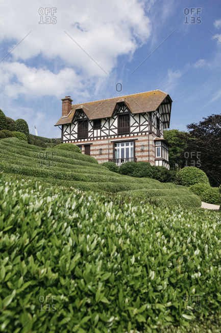 Etretat, Normandy, France - May 30, 2018: Hillside building, Les Jardins D'Etretat