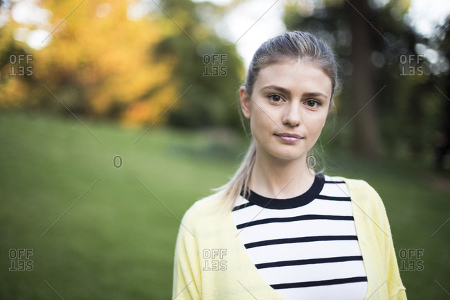 Portrait of a beautiful woman looking at camera in a park