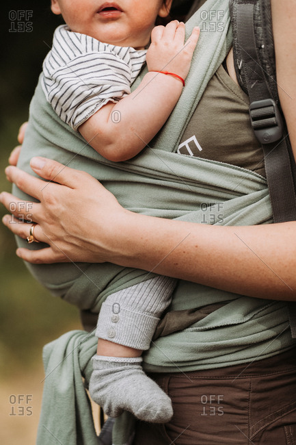 Mother carrying her baby while hiking
