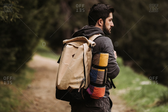 Backpacker hiking in the forest