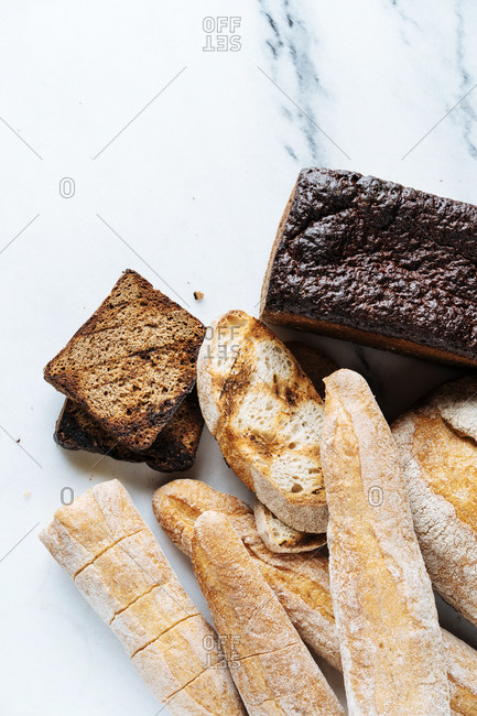 Variety of breads on a marble counter
