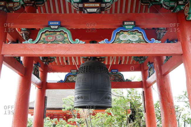 Kyoto, Japan - November 28, 2015: Large bell hanging from gate at the Kiyomizu dera Buddhist temple
