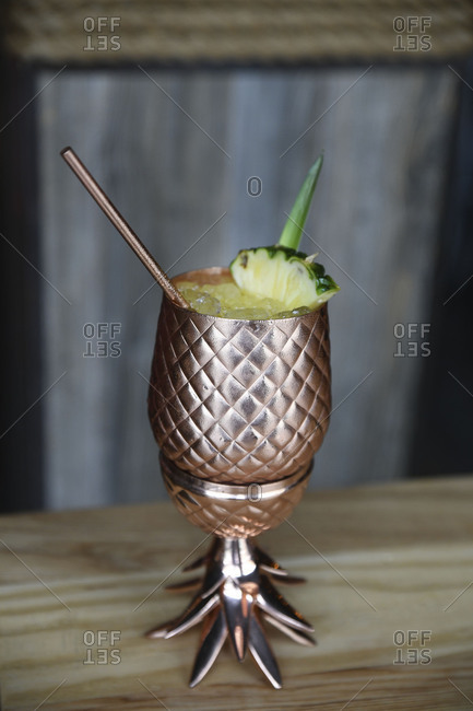 Chilled juicy cocktail served in metallic goblet