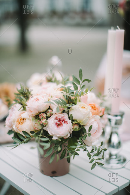Table outdoors, bridal bouquet, candles, still life