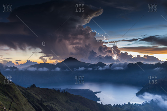 Scenery in the Gunung Rinjani, the crater lake, clouds, stormy atmosphere, flash