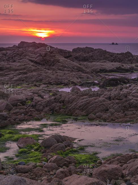 Sunset on rocky coast