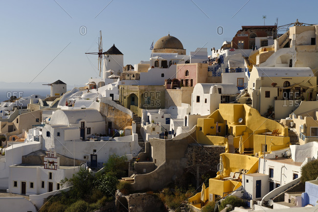 November 30, 2017: View at the terraces and windmills of Oia, island Santorin, the Aegean Sea, the Cyclades, Aegean islands, Greece,