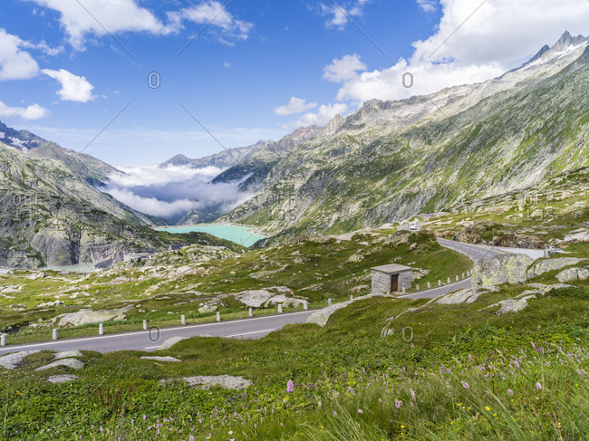 Grimsel mountain pass with reservoir Raterichsboden