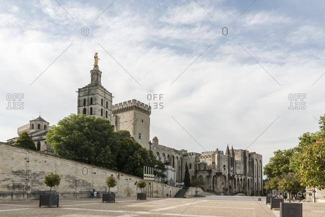 November 25, 2017: Avignon, Provence, Provence-Alpes-Cote dAzur, Vaucluse, Southern France, France, Palais des Papes (papal palace) in Avignon, Place du Palais, Cathedral of Notre Dame