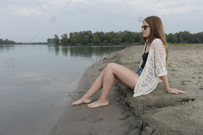 Young woman on the beach, quarry pond Liedolsheim, Dettenheim, Baden-Wurttemberg, Germany