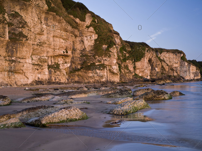 Northern Ireland, Antrim, Causeway Coast, steep coast made of mussel limestone close Ballintoy, blue hour