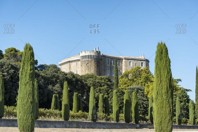 Suze-la-Rousse, Drome, Provence, Provence-Alpes-Cote dAzur, France, Renaissance castle Suze-la-Rousse built in in the 16th century, at dusk