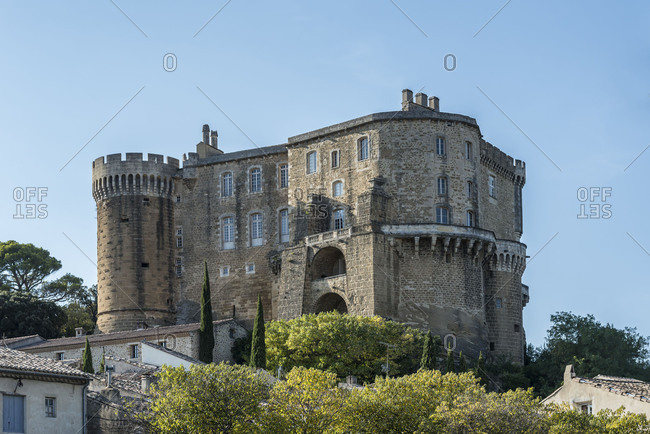 Suze-la-Rousse, Drome, Provence, Provence-Alpes-Cote dAzur, France, Renaissance castle Suze-la-Rousse built in in the 16th century, at dusk