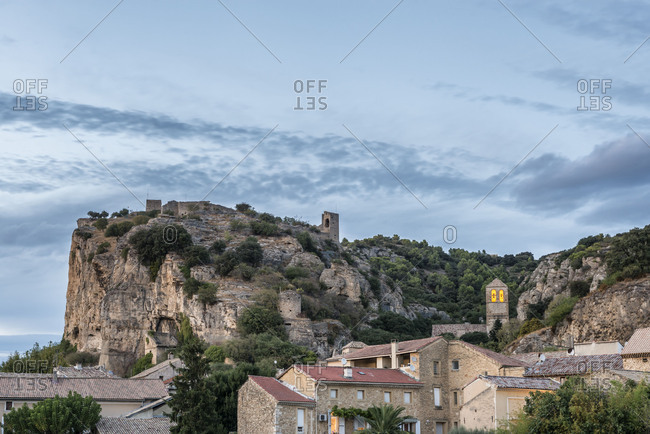 Mornas, Vaucluse, France, view of the Old Town of Mornas with the castle Monars on the limestone massif, Department Vaucluse in the region of Provence-Alpes-Cote dAzur, Arrondissement Carpentras, canton of Bollene.
