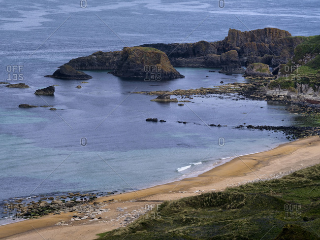 Northern Ireland, Antrim, Causeway Coast, sandy beach with basalt rock in the White park Bay