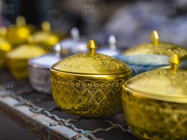Golden brass tins in a bazaar