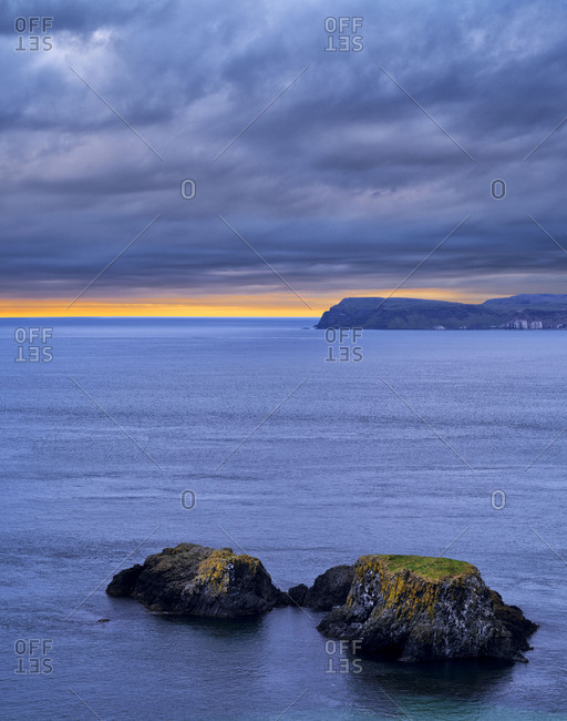 Northern Ireland, Antrim, Causeway Coast, rocky islands in the Causeway Coast, evening sky