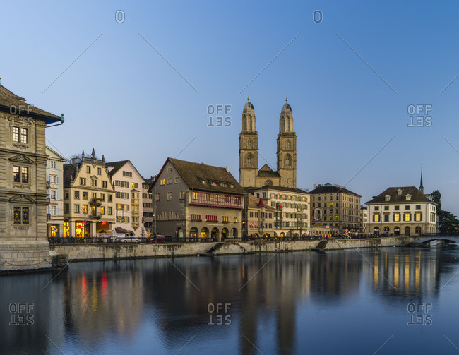Limmatquai with Grossmuenster, Haus zum Ruden and Helmhaus in the evening at the blue hour