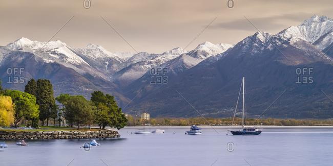 View of Locarno over Lake Maggiore with view of snowy Alps