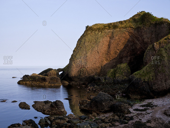 Northern Ireland, Antrim, Causeway Coast, bile formation on the coast close Cushendun, setting / stripe scenery of Stormlands, evening light