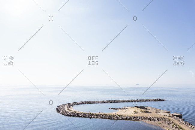 April 23, 2018: The pier of Vang, former port of debarkation of granite break, Europe, Denmark, Bornholm,