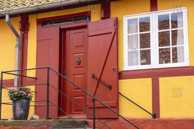 Yellow-red half-timbered house in the old town of Svaneke, Europe, Denmark, Bornholm,