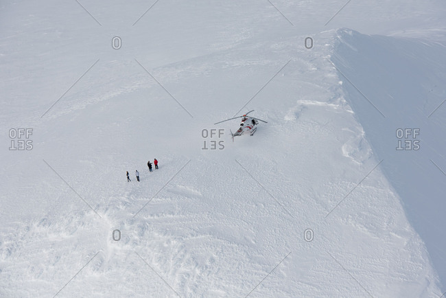 April 23, 2018: Helicopter landed on the snowy Eyjafjallajokull while the most beautiful winter weather in February, the pilot and three passengers got out