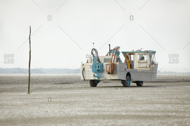 April 26, 2018: Amphibious vehicle on a beach on the Atlantic, cloudy sky