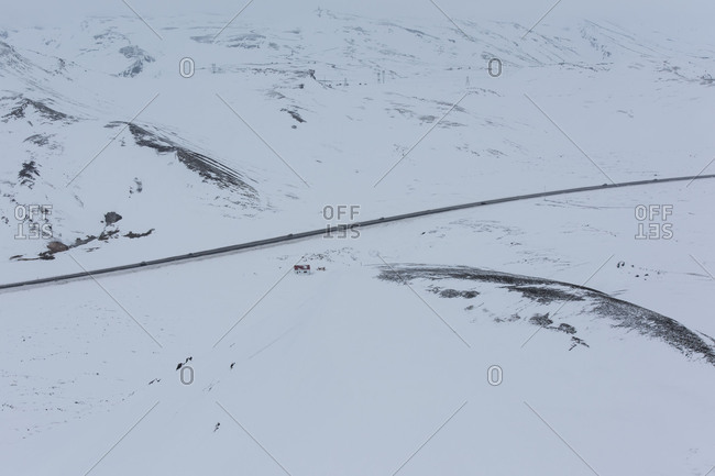 Iceland, birds eye view, cars on the ring road in the winter