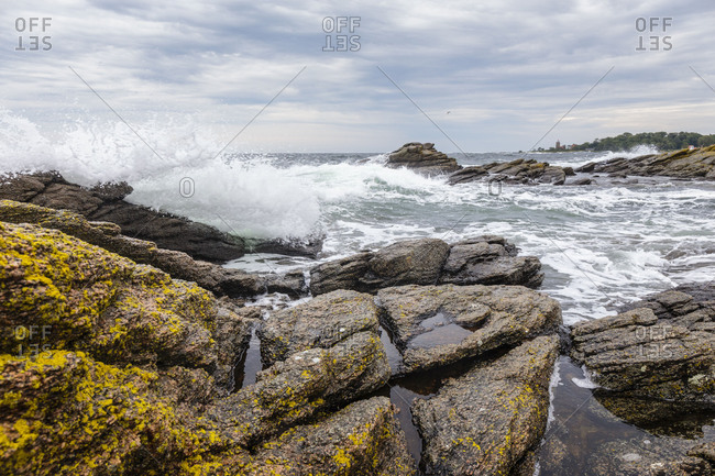 The stormy Baltic Sea at the harbor of Svaneke, the lighthouse (Svaneke Fyr) in the background, Europe, Denmark, Bornholm,