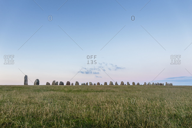 The stone circle of Ales stenar at dusk, Europe, Sweden, Loderup,
