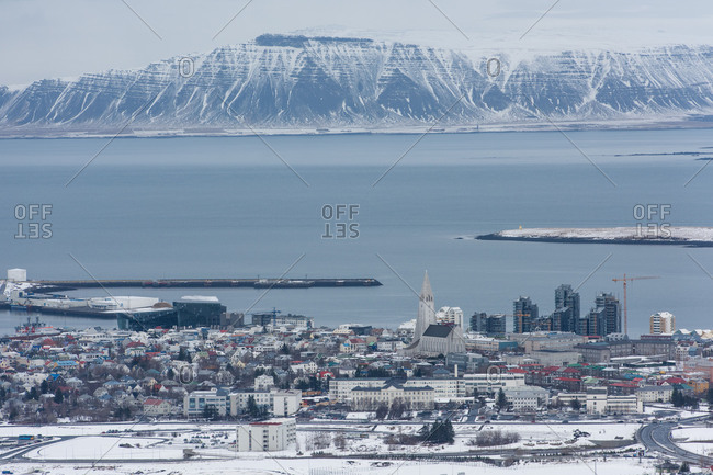 Center Reykjavik photographed from a Cessna, Hallgrimskirkja and Harpa are clearly visible, the Esja Mountains in the background