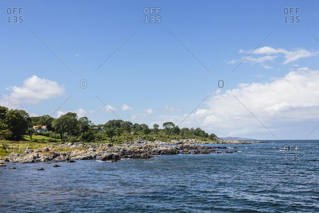 The coast at Bolshavn, in the background Gudhjem, Europe, Denmark, Bornholm, B�lsbakke,