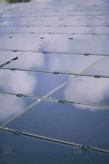 Cloudy sky reflecting on solar panels