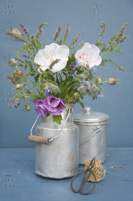 Bouquet with hibiscus in a milk jug