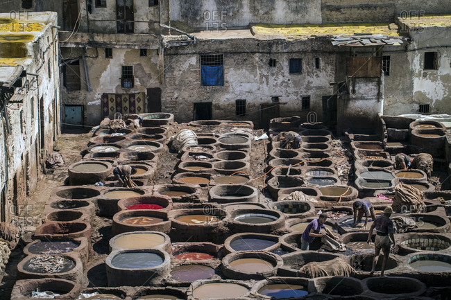 March 24, 2018: Color barrels in a tannery in Fez