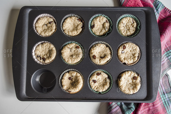 Overhead view of fresh muffins in baking tin