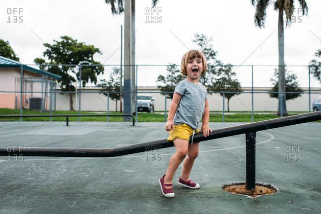 Toddler playing at a skate park