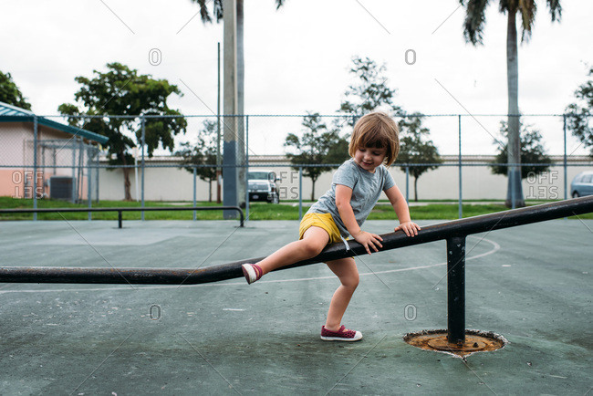 Little girl playing at a skate park