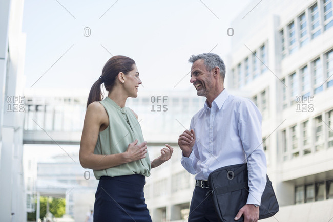 Two business partners communicating