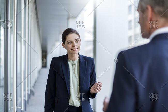 Portrait of smiling businesswoman listening to business partner