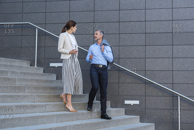 Two business partners discussing on stairs
