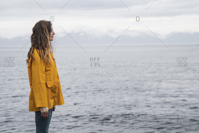 Iceland- woman standing at the sea