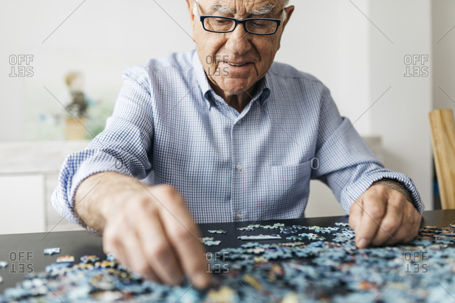 Senior man doing a jigsaw